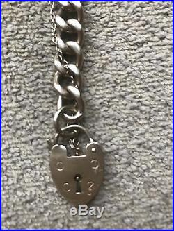 9 Ct Gold, Curb Chain Bracelet With Heart Padlock, 35.2 Grammes. Hallmarked