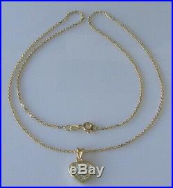 Secondhand 9ct gold multi princess cut diamond heart shape pendant & 9ct chain